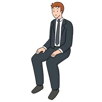 Pracownik biurowy siedzi