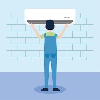 Pracownik instalujący klimatyzację na ścianie