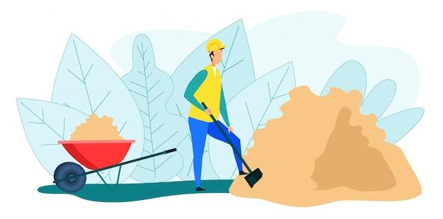 Pracownik kopanie stosu piasku umieścić na taczce