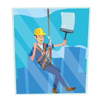 Pracownik myjący okna