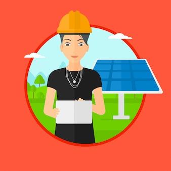 Pracownik płci żeńskiej elektrowni słonecznej.