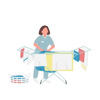 Pracownik pralni płaski kolor bez twarzy. gospodyni suszenia arkuszy ilustracja kreskówka na białym tle do projektowania grafiki internetowej i animacji. firma zajmująca się czyszczeniem odzieży, usługi sprzątania