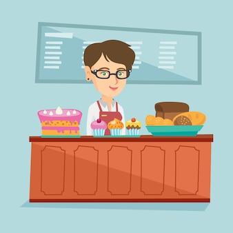 Pracownik stojący za ladą w piekarni.