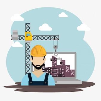 Pracownik w budowie z laptopem