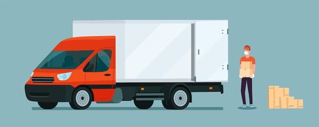 Pracownik w masce medycznej ładuje pudła do furgonetki.