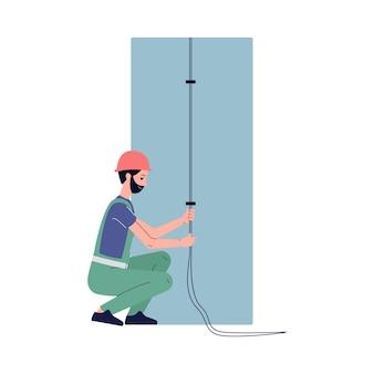 Pracownik zawodowy elektryk mężczyzna wykonuje prace elektryczne