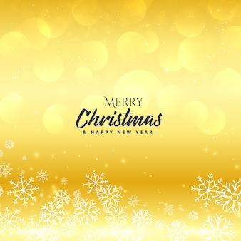 Premia złote wesołych świąt bożego narodzenia tła z płatki śniegu