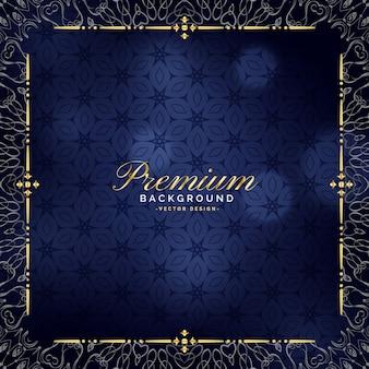 Premium niebieskie tło ze złotą dekoracją ozdobną