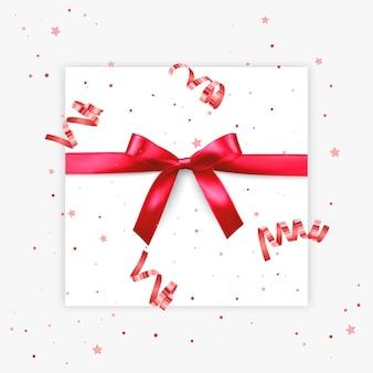 Prezent łuk realistyczna ilustracja białe tło czerwona wstążka ozdoba pudełka prezentowego