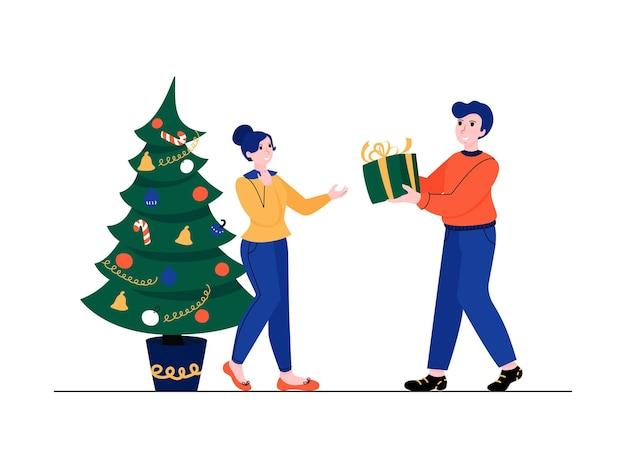 Prezent na boże narodzenie mężczyzna trzyma w rękach pudełko kobieta otrzymuje prezent od męża vector