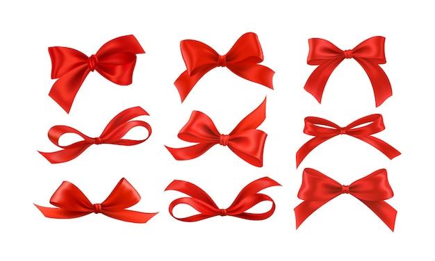 Prezentowe Kokardki Jedwabna Czerwona Wstążka Z Ozdobną Kokardką. Realistyczna, Luksusowa świąteczna Taśma Satynowa Do Dekoracji Premium Wektorów