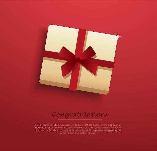 Prezentowe pudełko ozdobione czerwoną kokardką