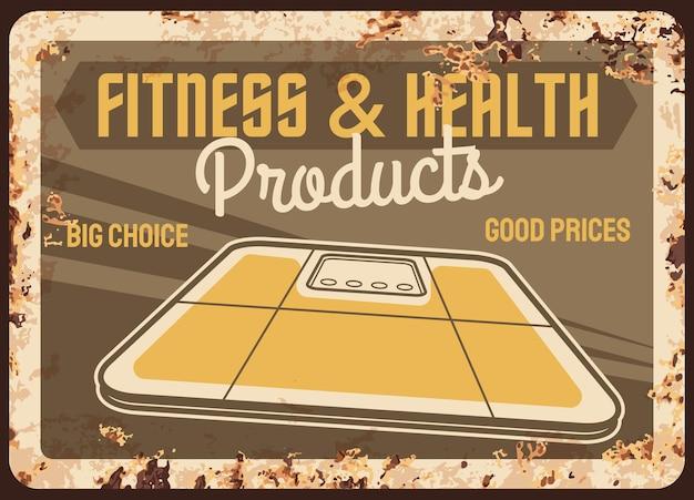 Produkty fitness i zdrowotne zardzewiały metalowy talerz z wagą podłogową