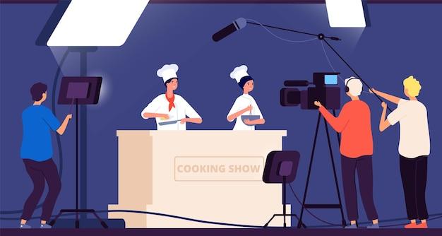 Program kulinarny. szef kuchni rozrywkę telewizyjną na żywo. ludzie w mundurach gotują w kuchni