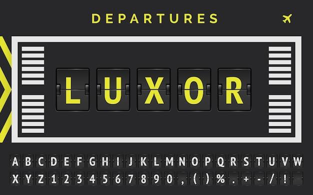 Projekt czcionki na pokładzie lotniska, zapowiadający loty do luksoru w egipcie, z oznaczeniem pasa startowego i ikoną samolotu.