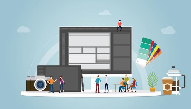 Projekt graficzny i koncepcja projektanta z ludźmi z zespołu i niektóre narzędzia, takie jak pantone i komputer typu tablet