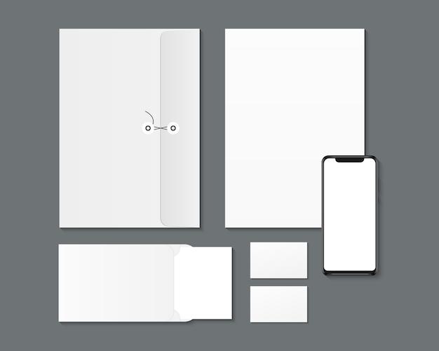 Projekt identyfikacji wizualnej marki. pusty smartfon, papier, koperty, makieta wizytówek.