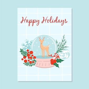 Projekt karty z pozdrowieniami wesołych świąt ze śnieżną kulą i reniferem, sosnowymi gałęziami, jagodami i słodyczami