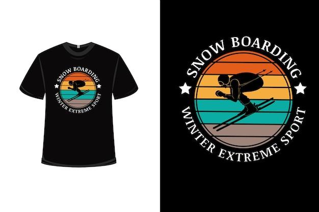 Projekt koszulki z zimowym sportem ekstremalnym na snowboardzie w kolorze pomarańczowo-żółtym i zielonym