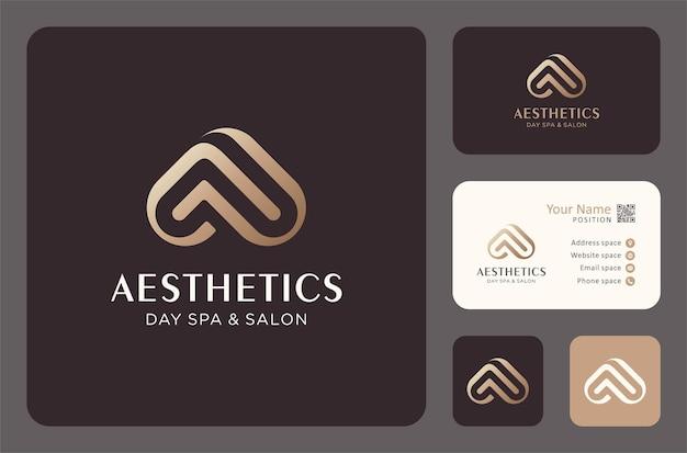 Projekt logo estetyki do pielęgnacji urody z szablonem wizytówki.