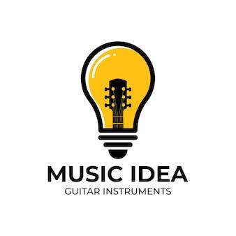 Projekt logo kreatywnego pomysłu na żarówkę i gitarę.