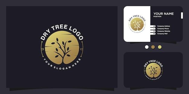 Projekt logo suchego drzewa w złotym stylu kreatywnym premium wektor