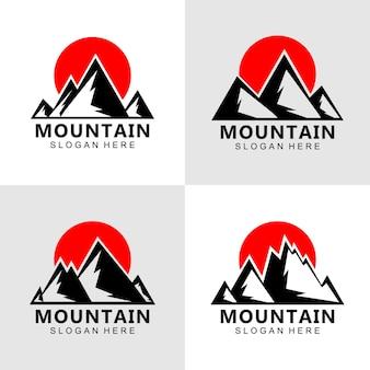 Projekt logo sylwetki górskiej o zachodzie słońca