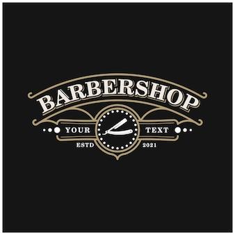 Projekt logo vintage odznaka dla zakładów fryzjerskich