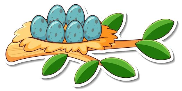 Projekt naklejki z jajami w ptasim gnieździe na białym tle