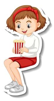 Projekt naklejki z postacią chłopca siedzącego i jedzącego popcorn
