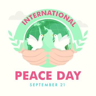 Projekt plakatu dzień pokoju międzynarodowego z ludzką ręką trzymającą kulę ziemską i gołębie na białym tle.