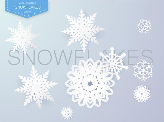 Projekt płatki śniegu na zimę z miejsca na tekst. streszczenie papierowe płatki śniegu