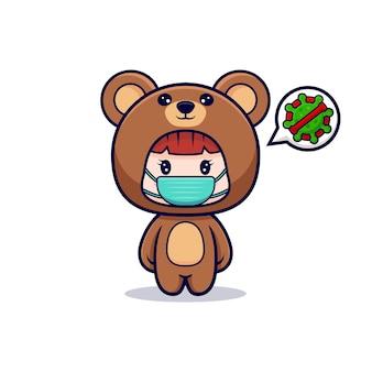 Projekt ślicznej dziewczyny w kostiumie niedźwiedzia i masce zapobiegającej wirusowi