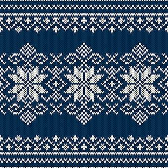 Projekt swetra winter holiday na wełnianej dzianinie. wzór