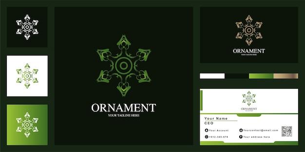 Projekt szablonu luksusowego logo gwiazdy lub ornamentu z wizytówką.