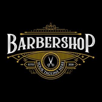 Projektowanie logo rocznika barbershop. vintage napis ilustracja premium na ciemnym tle.