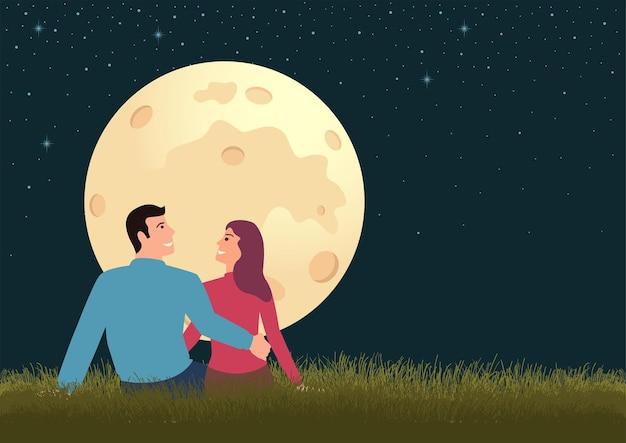 Prosta płaska para siedzi na trawie podczas pełni księżyca