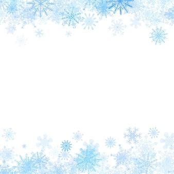 Prostokątna ramka z małymi niebieskimi płatkami śniegu