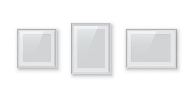 Prostokątne i kwadratowe białe ramki na zdjęcia lub obrazy na białym tle, zestaw vintage obramowania.
