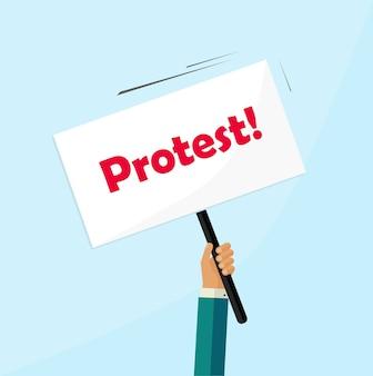 Protestujący ręka trzyma tablicę znak protestu