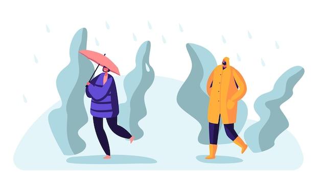 Przechodzień na mokrej deszczowej jesieni lub wiosennej pogodzie