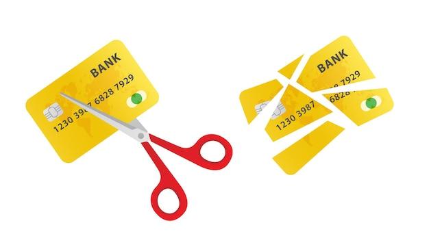 Przecinanie karty kredytowej nożyczkami nożyczki przecinanie starej karty kredytowej