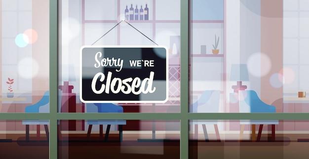 Przepraszam, że jesteśmy zamknięci znak wiszący przed kawiarnią okno koronawirus pandemia kwarantanny