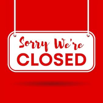 Przepraszamy, jesteśmy zamknięte drzwi znak na białym tle na czerwonym tle z cieniem
