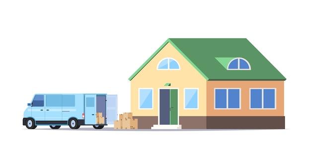 Przeprowadzka. minivan z kartonami i nowym domem.