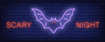 Przerażający noc neon stylu napis z świecące nietoperza na mur z cegły. Transparent jasny noc.