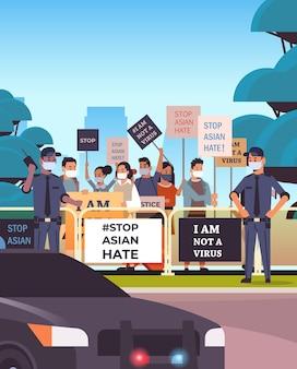 Przestań azjatycką nienawiść. osoby trzymające plakaty przeciwko rasizmowi. wsparcie podczas pandemii koronawirusa covid-19