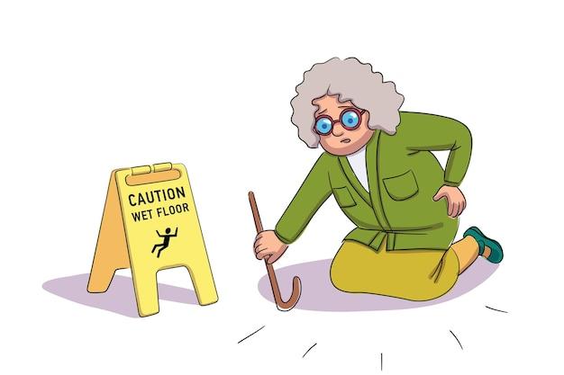 Przestraszona starsza kobieta spada w pobliżu uwaga na mokrej podłodze żółty znak