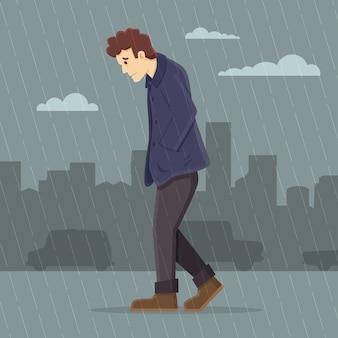 Przygnębiony mężczyzna spaceru w deszczu