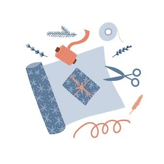 Przygotowanie do świąt bożego narodzenia koncepcja ozdobne rolki papieru do pakowania prezentowe nożyczki i wstążki na biurku t ...